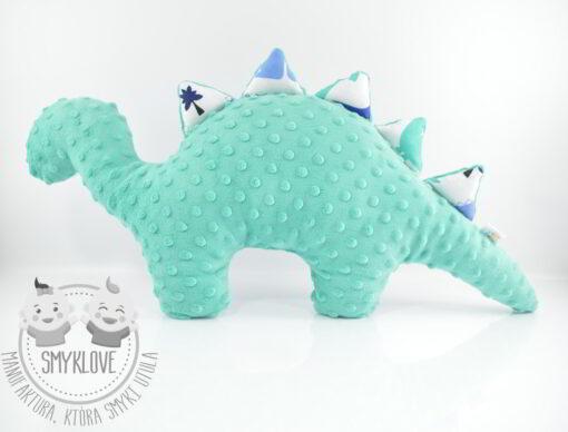 Maskotka dinozaur z drugiego profilu