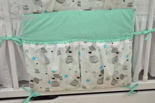 Dolne kieszonki przybornika do łóżeczka dziecięcego